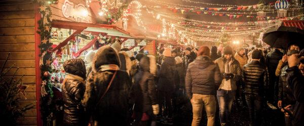 festive shoppers at a christmas market